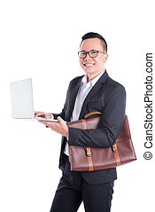 Young asian businessman using laptop computer over white background