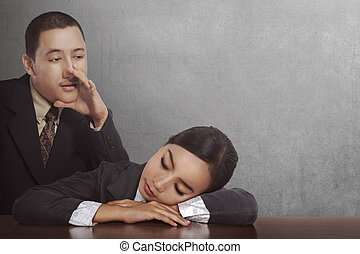 Young asian businessman wake sleep businesswoman