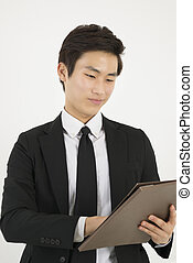 Young asian businessman with a file