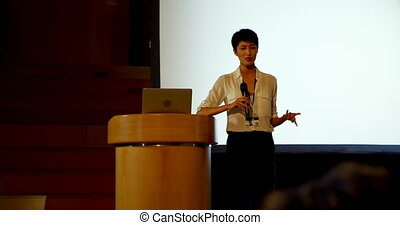 Young Asian businesswoman speaking in business seminar in ...