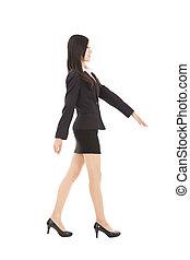 young asian businesswoman walking