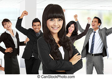 Young asian businesswoman, with her team behind
