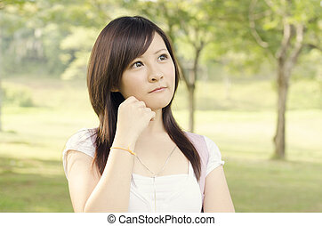 Young Asian college girl student thinking