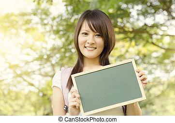 Young Asian college girl student with blank chalkboard