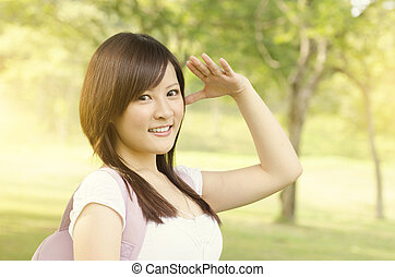 Young Asian college student smiling