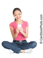 Young Asian college student using smartphone