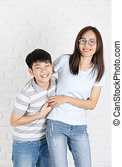 Young asian couple boy and girl on white wall background.
