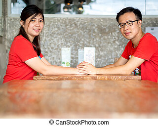 Young Asian Couple Holding Hands