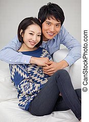 Young Asian couple in home