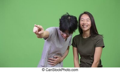 Young Asian couple laughing together