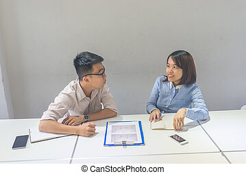 Asian employees talking in the meeting room