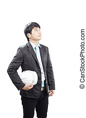 young asian engineering man standing and holding safety helmet i