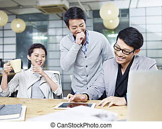 young asian entrepreneurs working in office