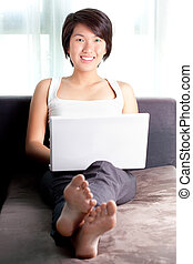 Young Asian executive checking email before work in morning