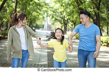 Young asian family with child having fun in nature park