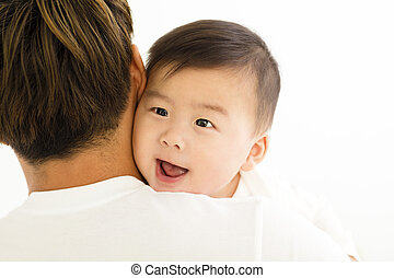 young asian father holding sweet baby boy