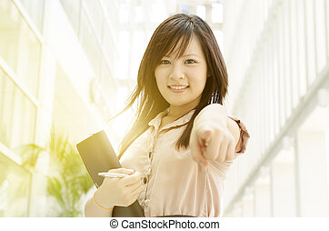 Young Asian female executive pointing at you