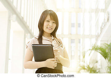 Young Asian female executive