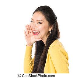 Young Asian female shouting