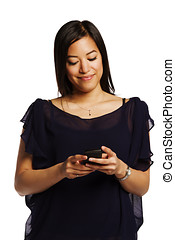 Young asian female smiling while reading a text on her cell phone - Isolated