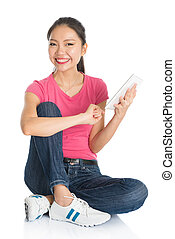 Young Asian female student using tablet pc