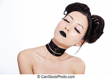 Young asian female with black makeup