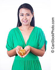 Young asian girl holding a gift box on white background