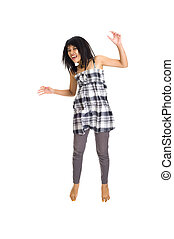 Young asian girl jumping for joy