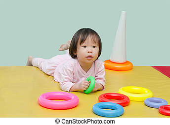 girl playing toy on floor