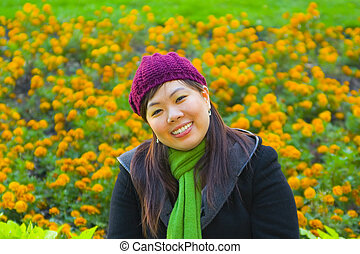 Young Asian Girl Sit On Flowers
