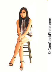 Young Asian girl sitting.