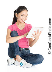 Young Asian girl student using tablet pc