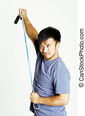 young asian guy with skipping rope on white background ready to training sport, lifestyle people concept