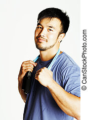 young asian guy with skipping rope on white background ready to