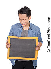 Young asian man holding blackboard on white background