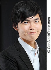 Young asian man in black suit