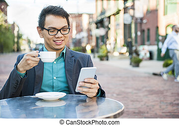Young asian man in outdoor cafe