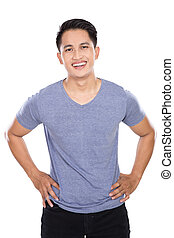 Young asian man posing hands on the waist, smile to the camera