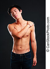 Young asian man relaxing on black background