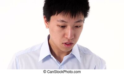 Young Asian man talking on smartpho