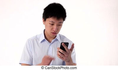 Young Asian man looking at his mobile phone, then taking , isolated on white