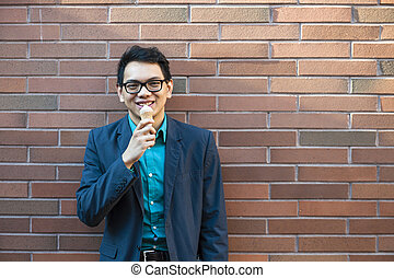 Young asian man with ice cream