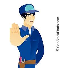 Young asian mechanic showing palm hand.