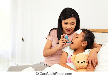 Young asian mother child sick care