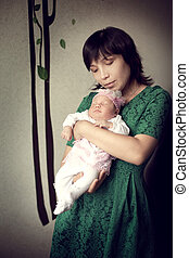 young Asian mother holding newborn baby girl