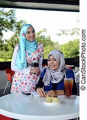 Young asian muslim woman in head sc