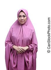 Young asian muslim woman wearing hijab smiling