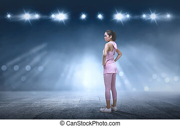 Young asian runner woman standing on concrete floor