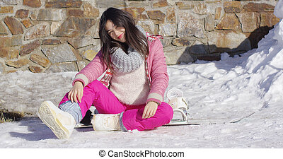 Young asian snowboarder girl relaxing