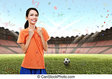 Young asian soccer player woman with excited expression